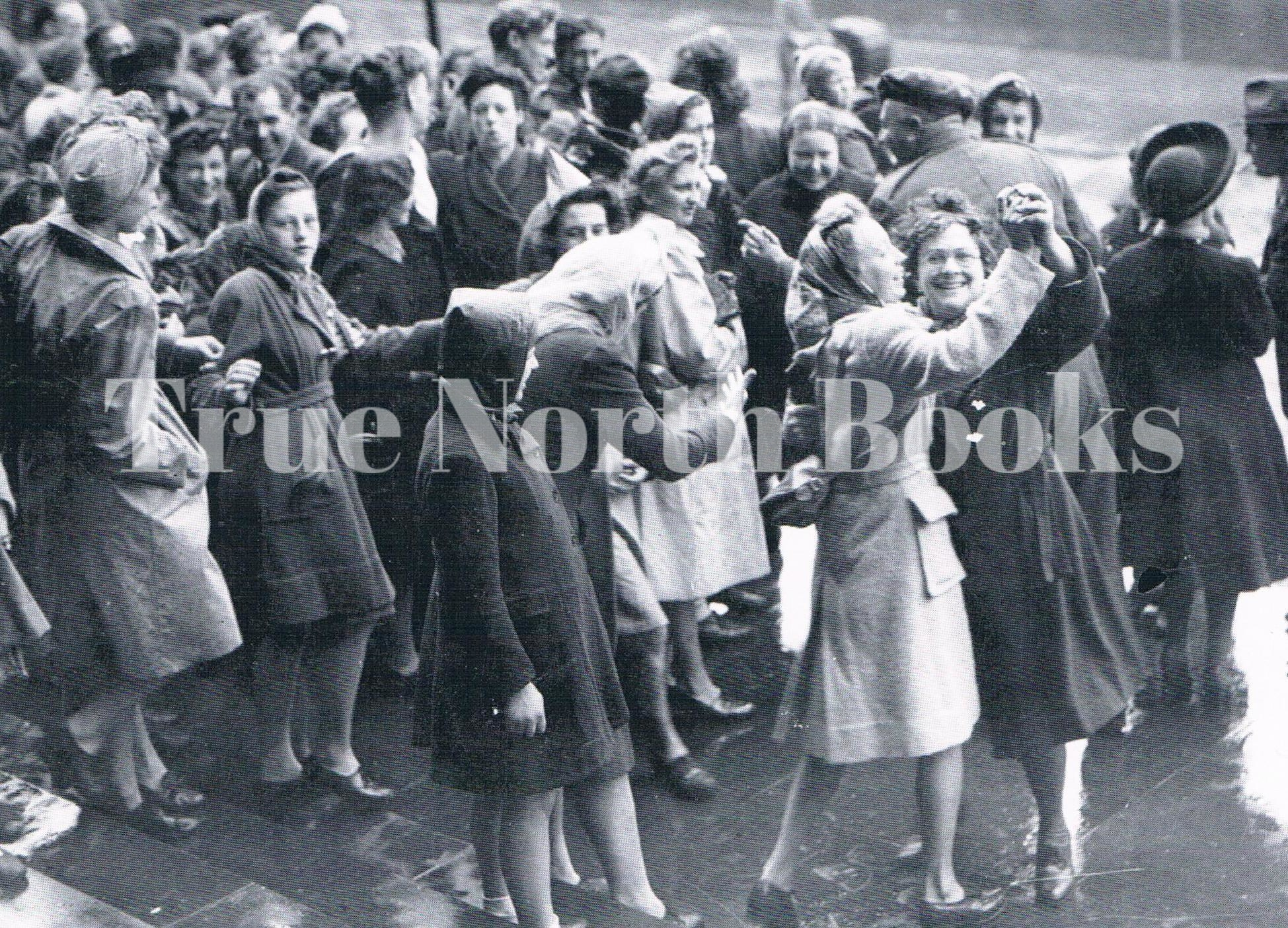 jumping for joy on vj day in leeds town hall women dancing (1)