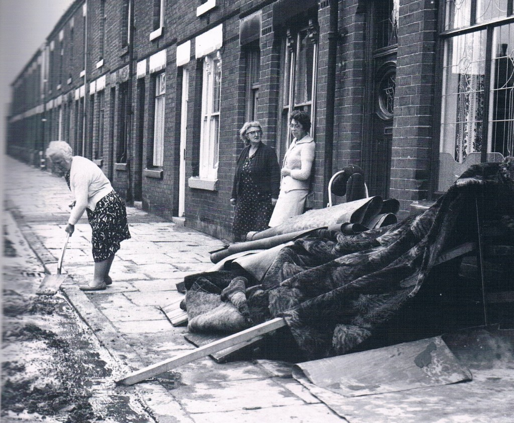 cleaning up operation of floods july 1969 bolton on wolfenden street. helping and chipping in. Dirty water, taken from nostalgic bolton book