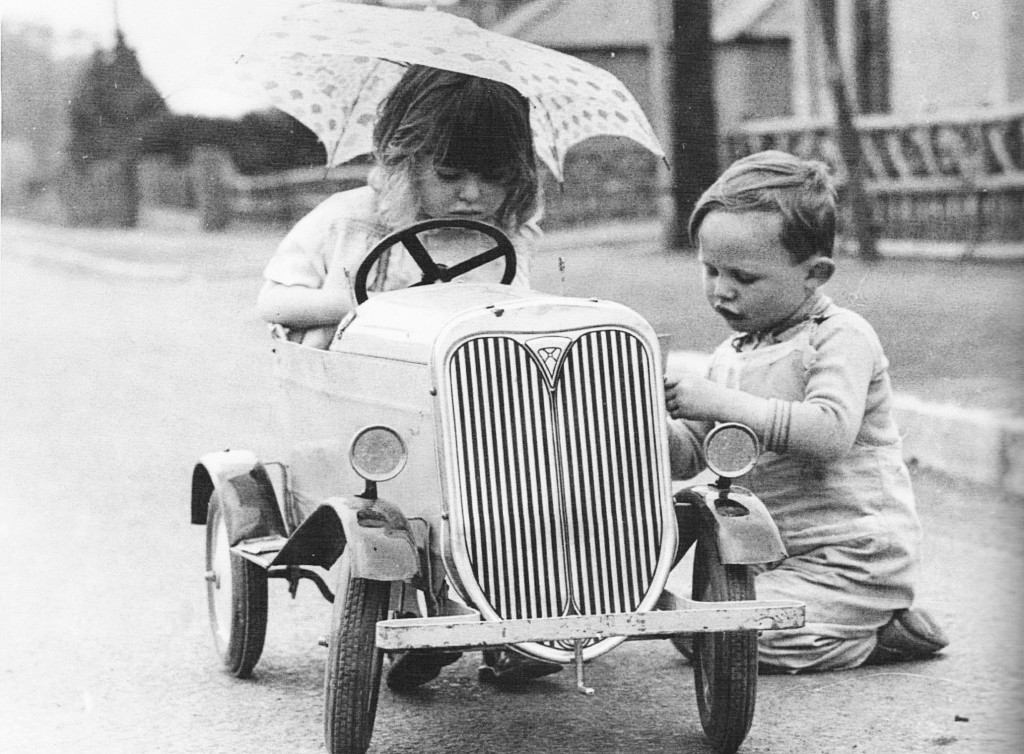 Young cardiff motorist in june 1936 plays cars with his passenger on sthe treet