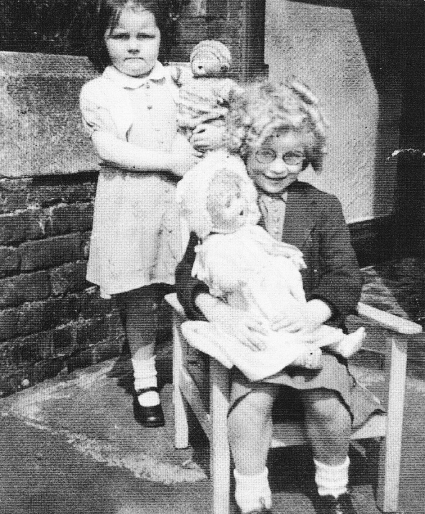 playing with dolls. from liverpool the golden years (50s)